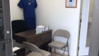 office with nurse uniform and desk and chair