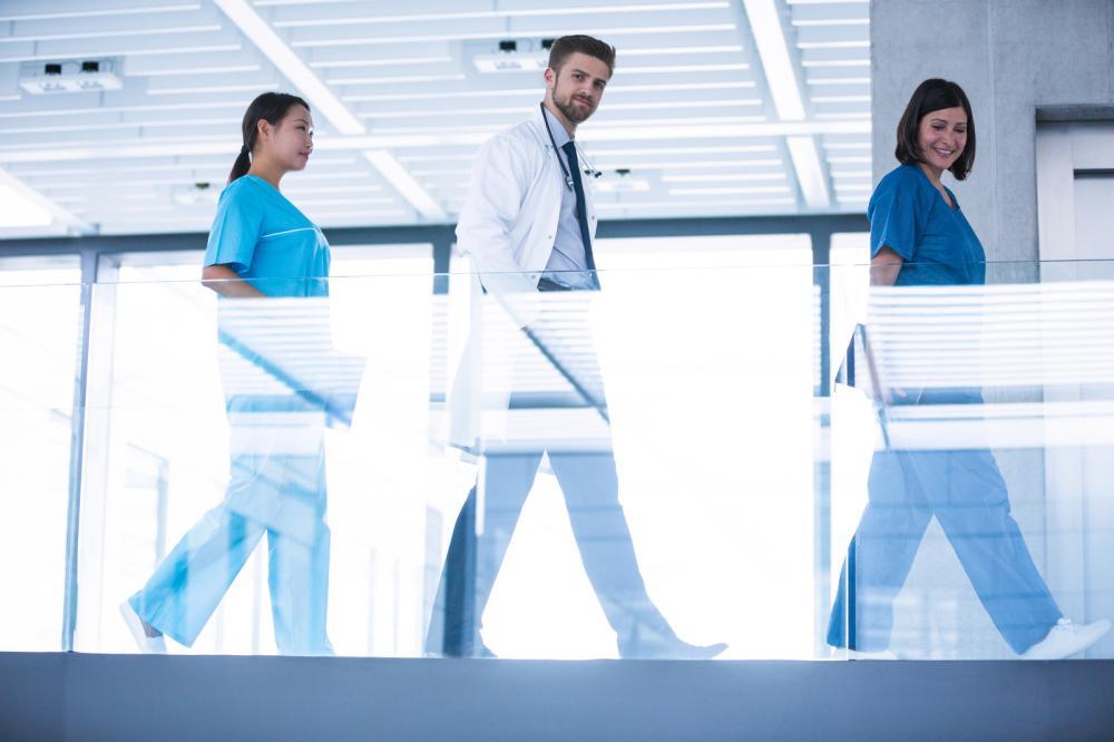 doctor-with-nurses-walking-in-corridor